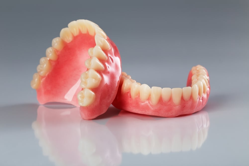 set of complete dentures on isolated background
