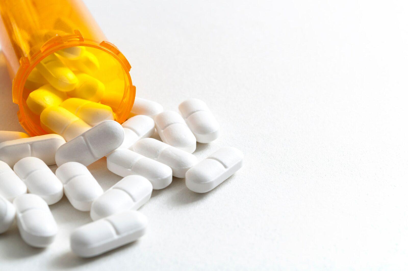 tablets spilling out of prescription bottle